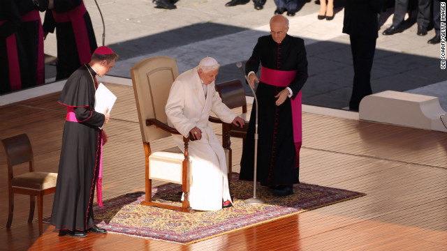 Benedict takes his seat on the dias in St. Peter's Square. In an unusually personal message, he said there had been &quot;many days of sunshine&quot; but also &quot;times when the water was rough ... and the Lord seemed to sleep.&quot;