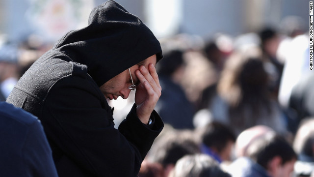 A pilgrim prays as he attends Benedict's final general audience address.