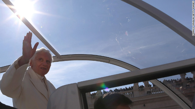 "Benedict waves to the faithful. ""Loving the church also means having the courage to make tough choices,"" he said, as he called on the faithful to pray for him and the new pope."