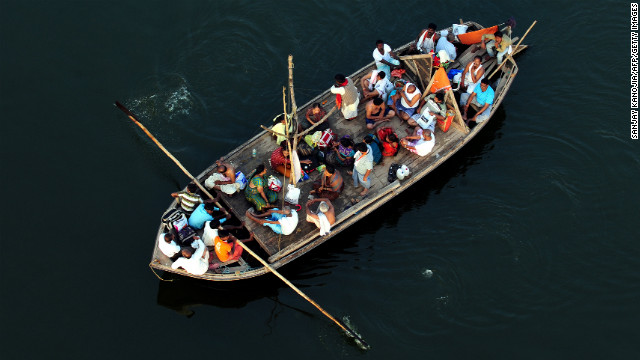 Hindu devotees return by boat after taking a holy dip at Sangam during the Kumbh Mela festival in Allahabad on Wednesday, February 27.