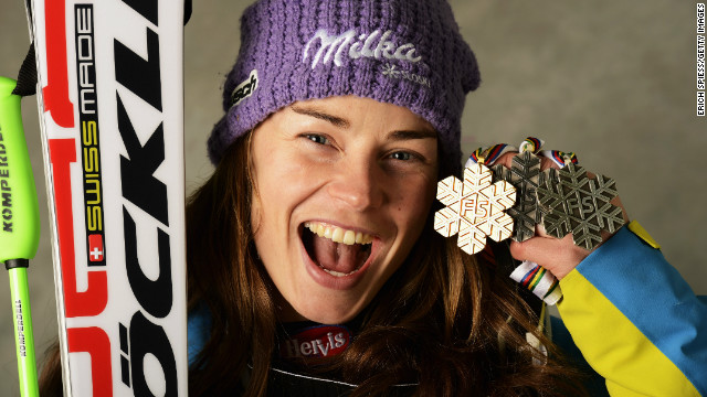 Maze shows off her gold medal from the super-G in Schladming.