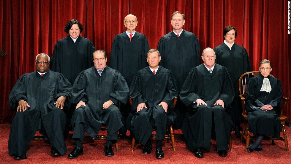 The justices of the U.S. Supreme Court sit for their official photograph on October 8, 2010, at the Supreme Court. Front row, from left: Clarence Thomas, Antonin Scalia, Chief Justice John G. Roberts, Anthony M. Kennedy and Ruth Bader Ginsburg. Back row, from left: Sonia Sotomayor, Stephen Breyer, Samuel Alito Jr. and Elena Kagan.