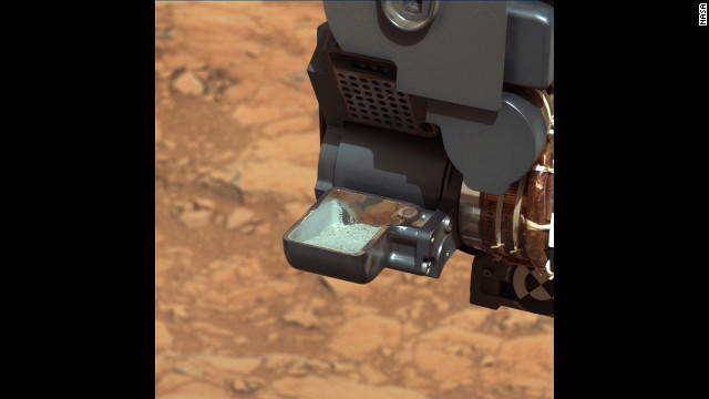 NASA's Curiosity rover shows the first sample of powdered rock extracted by the rover's drill. In subsequent steps, the sample will be sieved to be analyzed. The image was taken by Curiosity's mast camera on Wednesday, February 20.
