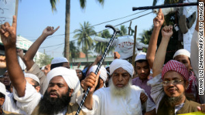 Supporters of Islamic political parties shout slogans inside a madrasa during a nationwide strike in Dhaka on Sunday. 