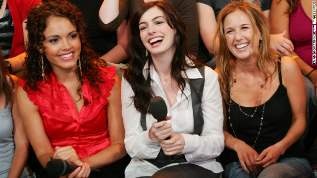Hathaway shares a laugh with VJ Susie Castillo, left, and her cousin Meredith Shevory on MTV's &quot;Total Request Live&quot; in 2006.