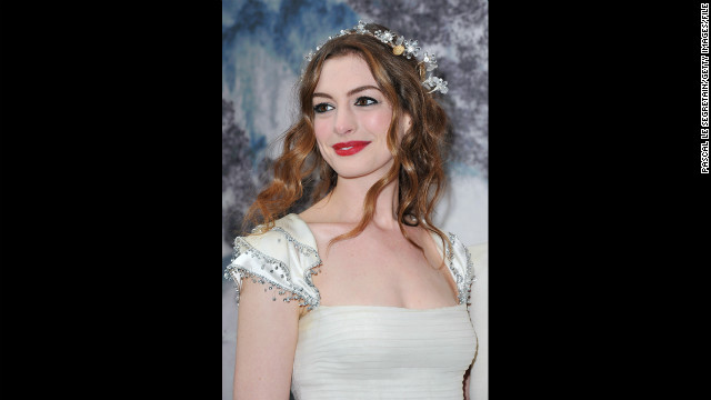 Hathaway dresses like a fairy at the White Fairy Tale Love Ball in support of the <a href='http://www.nakedheart.org/en/' target='_blank'>Naked Heart Foundation</a> in July 2011 in Crespieres, France. The charity seeks to build playgrounds for children in Russia.