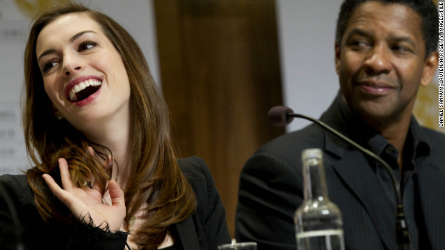 Hathaway and Denzel Washington at a December 2010 press conference in Oslo, Norway, ahead of the Nobel Peace Prize concert.