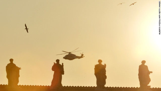 The helicopter with Pope Benedict XVI aboard flies past St. Peter's Square.