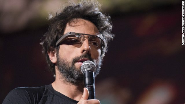 Google co-founder Sergey Brin wears his company's Google Glass headset while speaking Wednesday at TED.