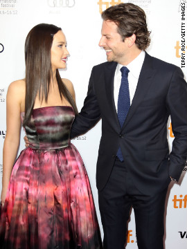 "We know it's called ""acting"" for a reason, but didn't you kind of buy that Lawrence and Bradley Cooper were really a couple after they appeared in ""Silver Linings Playbook""? Cooper, shown with Lawrence during the 2012 Toronto International Film Festival, <a href='http://marquee.blogs.cnn.com/2013/01/15/bradley-cooper-denies-dating-j-law-i-could-be-her-father/' target='_blank'>set the record straight</a> by saying he was old enough to be her dad."