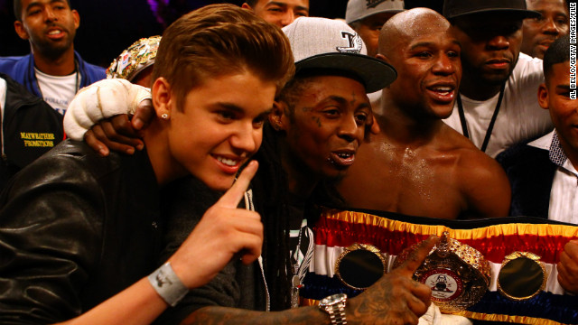 Bieber makes his bread and butter as a teen pop phenom, but his social circle is wide. His appearance as part of boxer Floyd Mayweather Jr.'s entourage at a fight in May 2012 had everyone doing a double take. Lil Wayne and 50 Cent were also on hand.