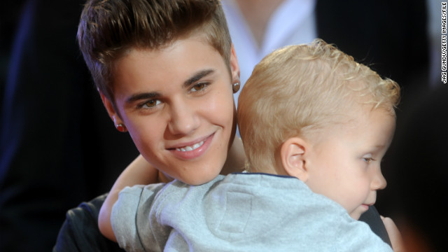 In June 2012, the singer was all smiles as he held baby brother Jaxon at the MuchMusic Video Awards in Toronto.