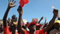 Supporters of the Nationaql Alliance, TNA presidential candidate Uhuru Kenyatta cheer during his address on February 23, 2013 at Oloitokitok