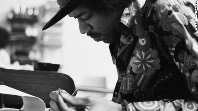"<strong>Hendrix at the Record Plant in 1968:</strong><!-- --> </br>""Jimi had the habit of making the final draft of a song he was working on just before he went into the booth to record the vocal. This photo shows a smiling Jimi putting the final touches to 'Gypsy Eyes' from the many notes he kept with him usually written on hotel stationery, napkins or matchbook covers. These would be assembled on a yellow legal pad just prior to singing the final vocal. An interesting observation is that he wrote right-handed even though he played lefty."" --<i> Eddie Kramer</i>"
