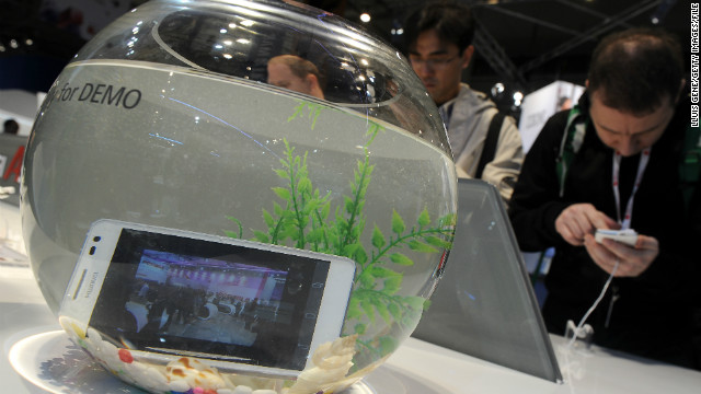 Chinese manufacturer Huawei dunks its Ascend D2 in a bowl of clear liquid at the 2013 Mobile World Congress in February.