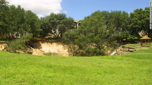 In Orlando, a sinkhole 150 feet wide and 60 feet deep swallowed trees, pipelines and a section of sidewalk near an apartment building in June 2002.