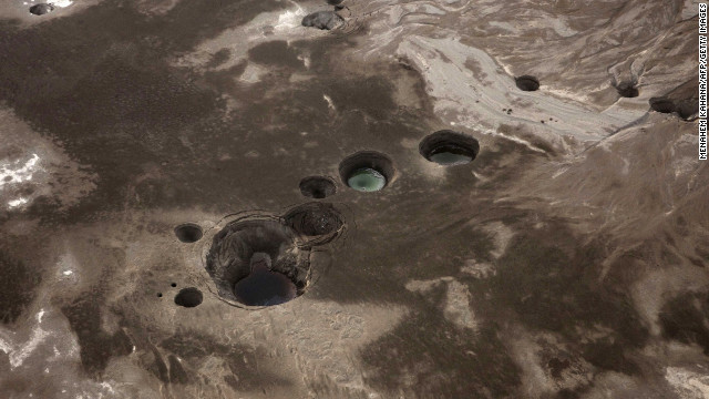 An aerial photo shows sinkholes created by the drying of the Dead Sea near Israel in 2011. 
