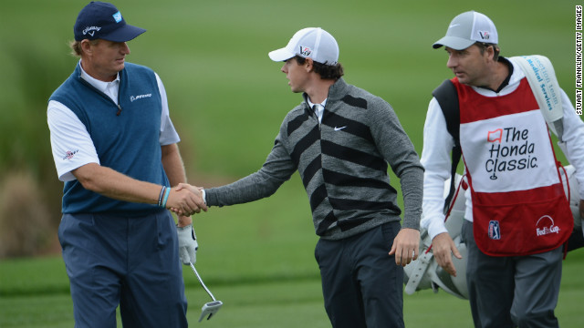 McIlroy shakes hands with British Open champion Ernie Els before making his exit from the Honda Classic in Florida.