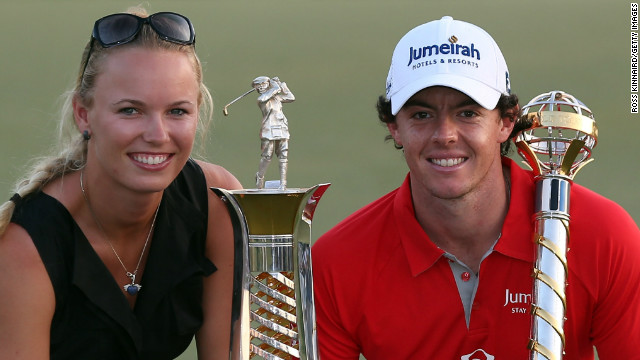 McIlroy and his girlfriend Caroline Wozniacki celebrate his winning the European Tour title with victory in the final event of the 2012 season in Dubai. 