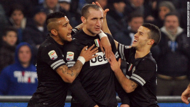 Giorgio Chiellini is congratulated by teammates after putting Juventus into the lead at Napoli.