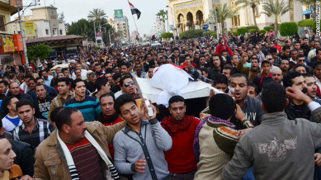Egyptians on Saturday carry the body of a person killed in clashes between police and protesters in the city of Mansoura.