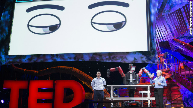 Rodney Brooks, right, introduces Baxter, a robot that can perform tasks in a variety of manufacturing settings.