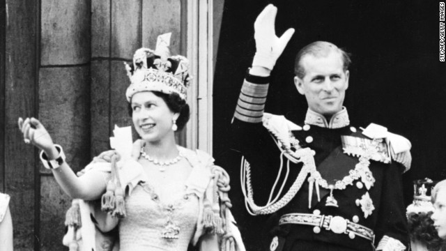 Queen Elizabeth, accompanied by her husband, Prince Philip, the Duke of Edinburgh, waves to the crowd on June 2, 1953, after being crowned at Westminster Abbey in London. Her coronation was the first worldwide televised event.