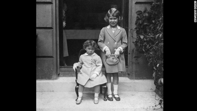 Princess Elizabeth Alexandra Mary, right, poses for a photo with her younger sister, Princess Margaret, in 1933.