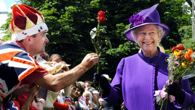 Elizabeth is offered a rose by a well-wisher while visiting the Princess Diana memorial fountain in London's Hyde Park in July 2004.