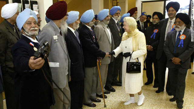 Elizabeth greets veterans at the Gurdwara Sri Guru Singh Sabha, a Sikh Temple in London, in October 2004.