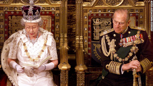 Elizabeth sits beside Philip as she gives a speech at the state opening of Parliament in the House of Lords in November 1999.