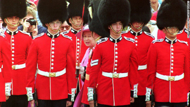 Elizabeth inspects the Canadian Guard of Honour in July 1992 before taking part in Canada Day celebrations in Ottawa.
