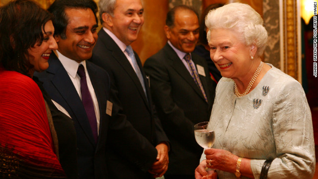 Elizabeth meets actors Sanjeev Bhaskar, second left, and Meera Syal, left, after watching a performance by Nutkhut, a London-based dance company, at Buckingham Palace in October 2009. 