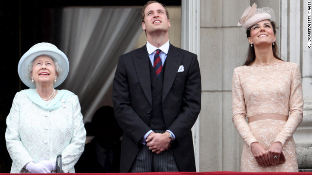 Queen Elizabeth, from left, Prince William, and Catherine, Duchess of Cambridge, look up from the balcony of Buckingham Palace after the service of thanksgiving at St. Paul's Cathedral in June 2012.