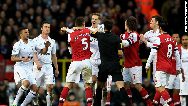 Tenisons threatened to boil over as Tottenham captain Michael Dawson and Arsenal skipper Thomas Vermaelen reacted angrily after the visiting team decided not to kick the ball out of play for Emmanuel Adebayor to receive treatment.