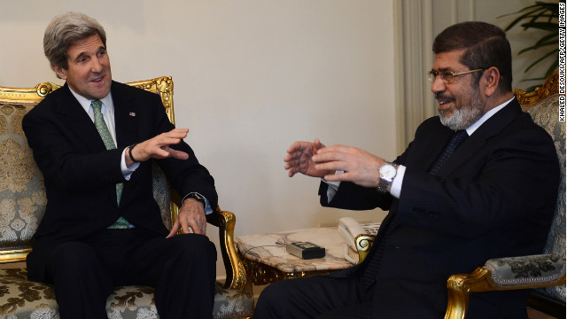 U.S. Secretary of State John Kerry talks with Egyptian President Mohamed Morsy at the presidential palace in Cairo on Sunday.