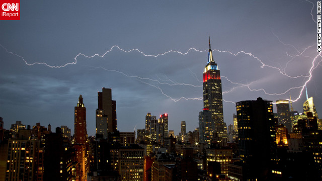 "<a href='http://ireport.cnn.com/docs/DOC-821097'>Matthew Burke</a> shot this dramatic lightning strike from his Manhattan apartment window in July 2012. ""There was very strong rain and wind for about 15 minutes, at which point the rain cleared and the lightning show began,"" he said."