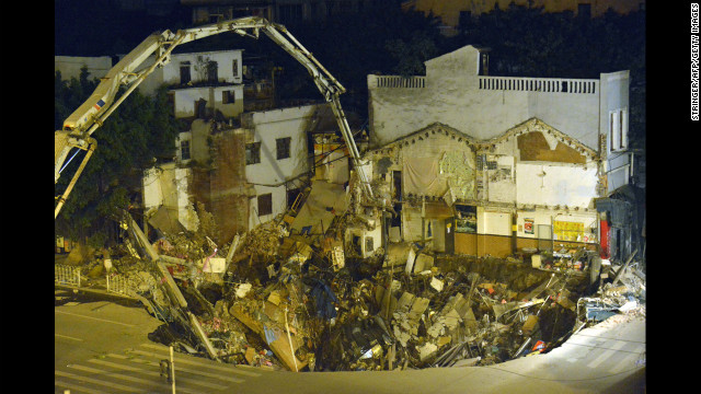 Buildings fell into a sinkhole near a subway construction site January 2013 in Guangzhou, south China's Guangdong province. The hole measured about 1,000 square feet across, 30 feet deep and was without casualties, according to a state media report.