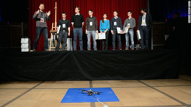 D'Andrea advises a small group of grad students at ETH Zurich. Together they are creating ever more complex tasks for their fleet of quadrocopters. Here the group can be seen onstage during a presentation at a <a href='http://zurichminds.com/' target='_blank'>Zurich Minds</a> event last year.