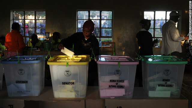 A voter puts a ballot paper into the senatorial box as voting kicked off in Kenya on March 4, 2013 in the country's western province in Kakamega. Long lines of Kenyans queued from far before dawn to vote Monday in critical elections, the first since violent polls five years ago, with five policemen killed in an ambush in Mombasa hours before polling started.