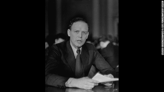 "While in self-induced exile in Europe, legendary aviator Charles Lindbergh became an advocate for the prevention of World War II. In 1938, Lindbergh penned a secret memo to the British, stating that military response to Adolf Hitler's violation of the Munich Agreement would be ""suicide."" In 1941, he spoke on behalf of the isolationist America First Committee in Des Moines, Iowa, claiming that if the U.S. were to engage in war against Germany, victory would not be likely. Here, Lindbergh testifies before the House Foreign Affairs Committee in January 1941."