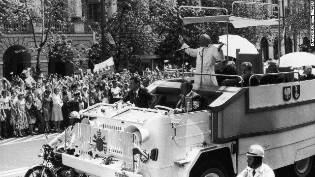 1980: Pope John Paul II waves to the crowds from his custom-built truck during a visit to his homeland Poland.