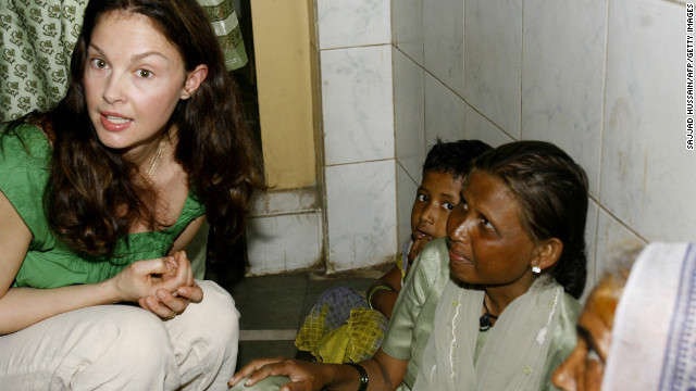 Actress Ashley Judd, a global ambassador for YouthAIDS, actively campaigns for awareness of international poverty. In 2010, Judd traveled to the Democratic Republic of Congo to raise awareness of how sexual violence is driven by conflict minerals in Congo. Judd has met with several heads of states and political leaders and recently her political involvement and possible run for a U.S. Senate seat in Kentucky has come under fire from conservative super PAC American Crossroads. Pictured, Judd speaks with Indian women while touring to promote AIDS awareness in Mumbai, March 2007.