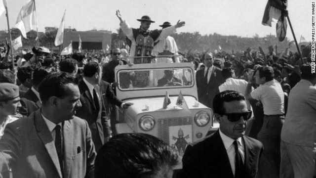 1964: During a visit to the John Bosco School in India, Pope Paul VI drives through the crowds with a convoy of bodyguards.