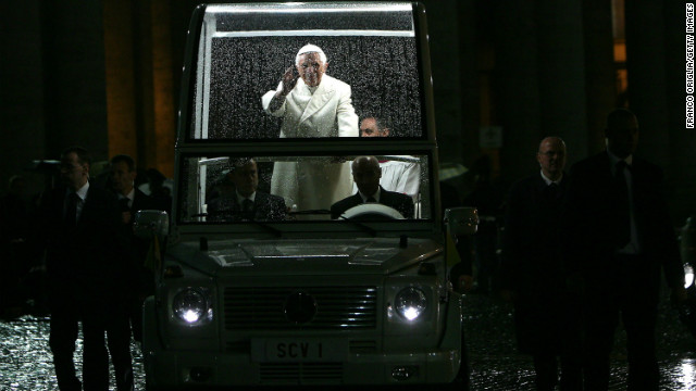 Pope Benedict XVI waves as he arrives in St. Peter's Square after leading the Te Deum prayer on December 31, 2009 in Vatican City, Vatican. The lights inside the Popemobile enable the crowds to see inside the vehicle.