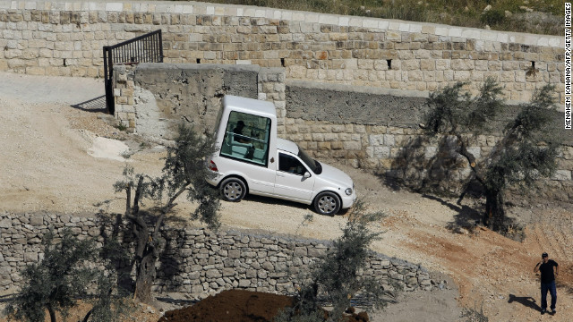 An Israeli worker drives the Popemobile during a rehearsal on May 6, 2009 at the foot of the Mount of Olives in Jerusalem. Israel's internal security agency was originally opposed to the pontiff using his Popemobile while in Nazareth on a tour of the Holy Land, according to a government document presented to the weekly Cabinet meeting on April 26.