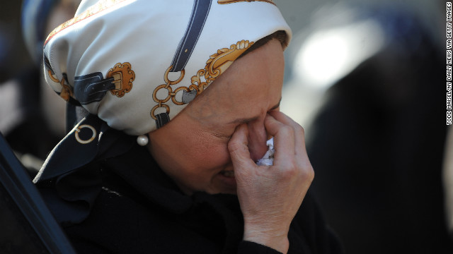A woman cries during the funeral.