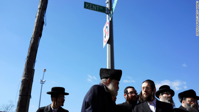 Members of the Brooklyn Orthodox Jewish community attend a news conference on Monday, March 4. 