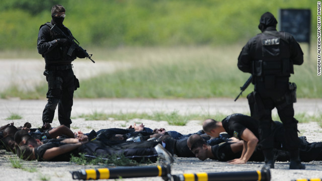 Police commandos from an anti-kidnapping unit, arrest and control a group of 'terrorists' during a drill at the Tom Jobim International Airport in Rio de Janeiro, Brazil, on January 13, 2012.