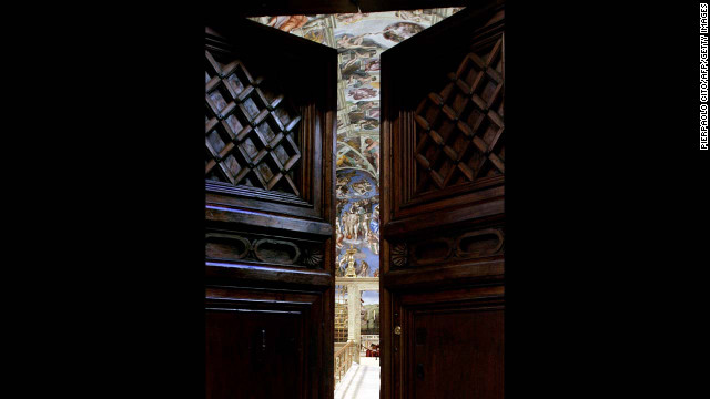 "Michelangelo's ""The Last Judgment"" is seen through the Sistine Chapel doors on April 16, 2005."